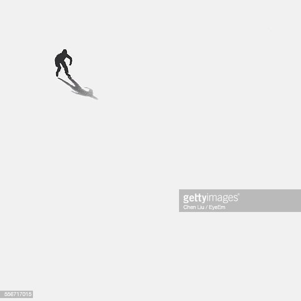 High Angle View Of Person Ice-Skating On Frozen Lake
