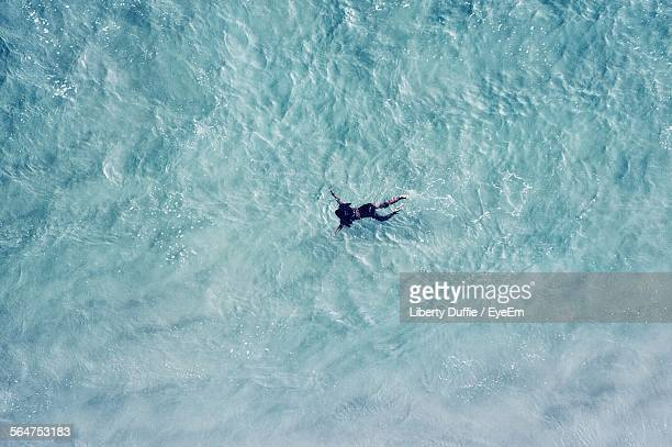 High Angle View Of Person Swimming In River