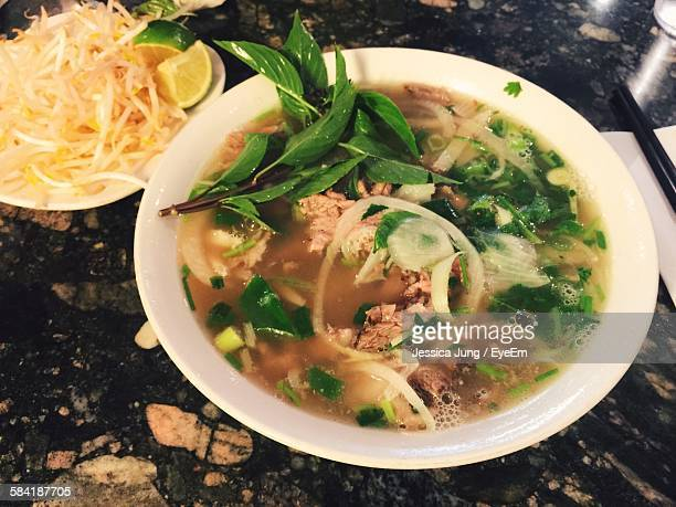 High Angle View Of Pho Served In Bowl On Granite