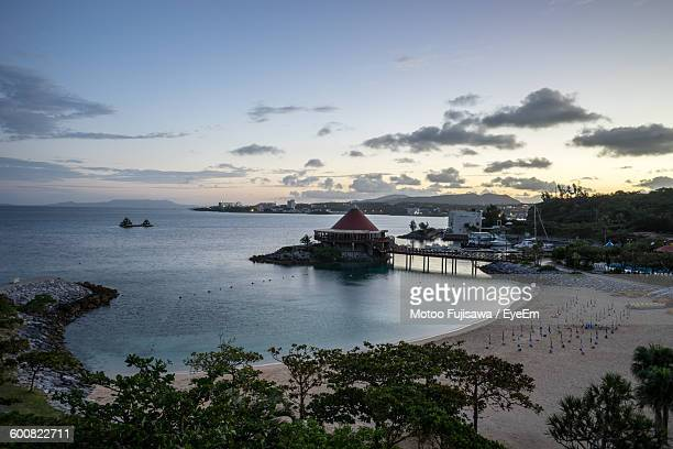 High Angle View Of Pier On Sea Against Sky During Sunset At Renaissance Resort Okinawa