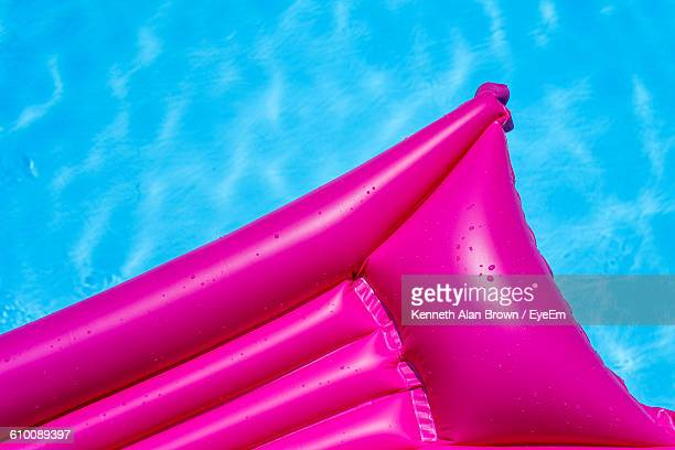 High Angle View Of Pink Inflatable Raft In Swimming Pool