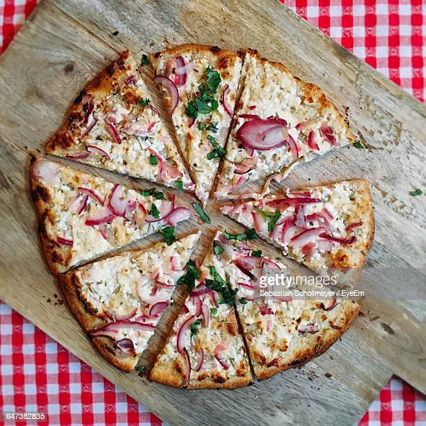 High Angle View Of Pizza On Wooden Board