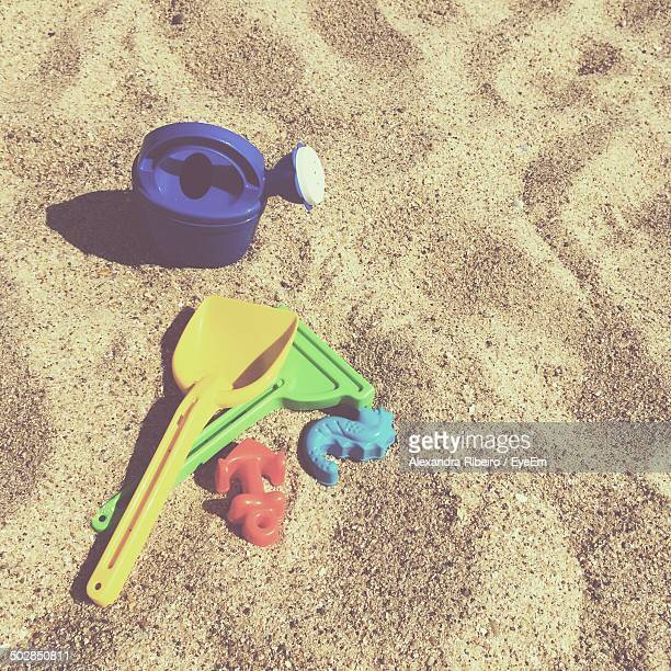 High angle view of plastic toys on sand