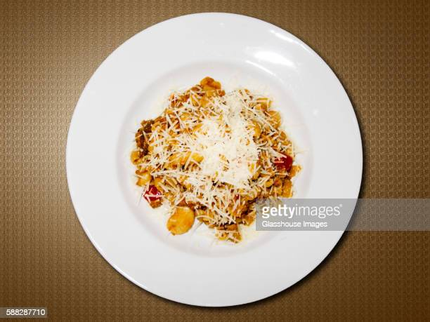 High Angle View of Plate of Pasta Sprinkled With Parmesan Cheese