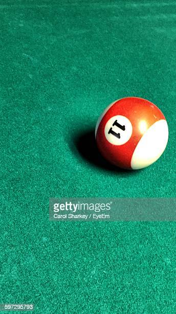 High Angle View Of Pool Ball With Number 11 On Table