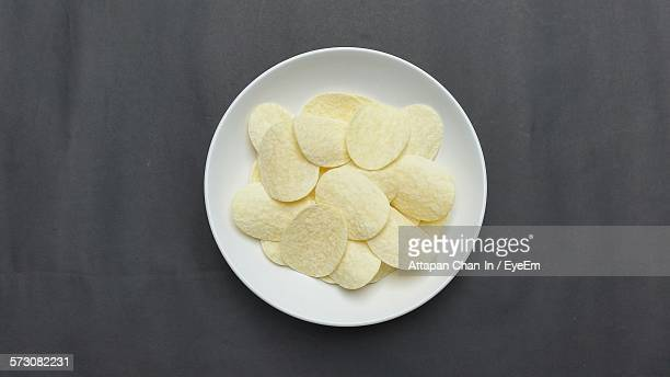 High Angle View Of Potato Chips On Plate At Home
