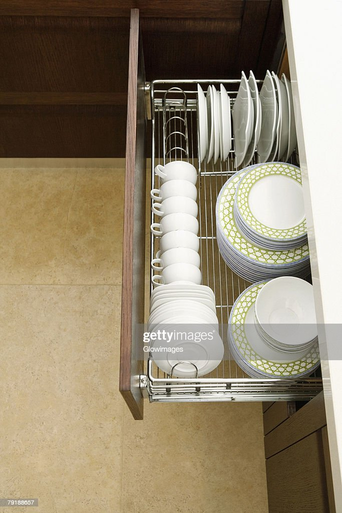 High angle view of potteries in a kitchen cabinet : Stock Photo