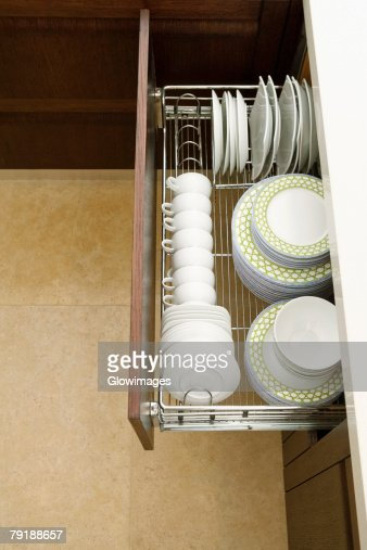 High angle view of potteries in a kitchen cabinet : Foto de stock
