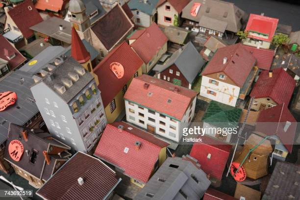 High angle view of price tags on roof of model houses for sale