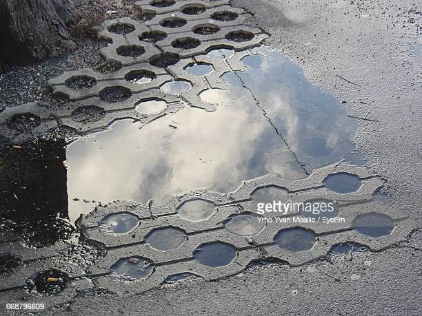 High Angle View Of Puddle At Roadside