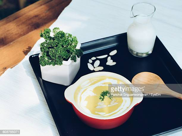 High Angle View Of Pumpkin Soup In Bowl On Tray