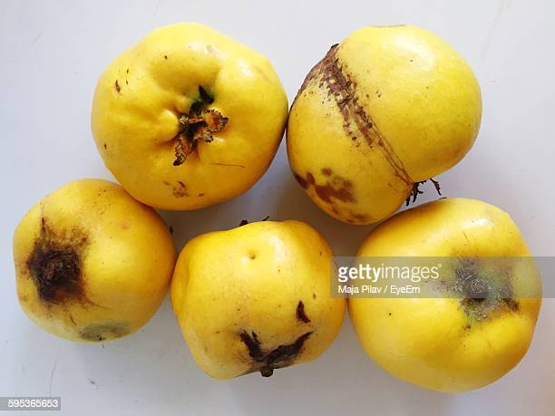 High Angle View Of Quince Fruits On White Table
