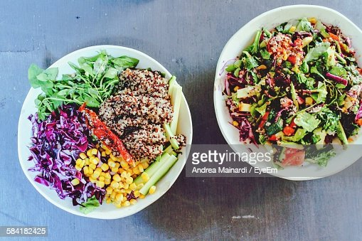 High Angle View Of Quinoa Salad Bowls On Table