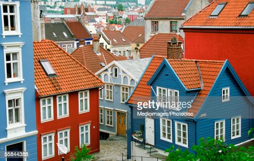 High Angle View Of Red And Blue Wooden Houses With Tiled