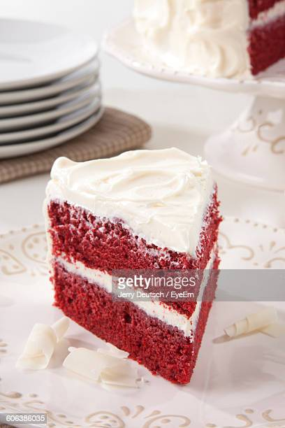 High Angle View Of Red Velvet Cake Slice Served In Plate