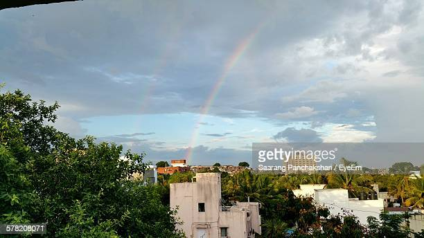 High Angle View Of Residential District Against Sky With Double Rainbow