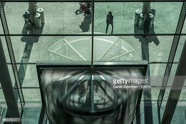 High Angle View Of Revolving Door And People