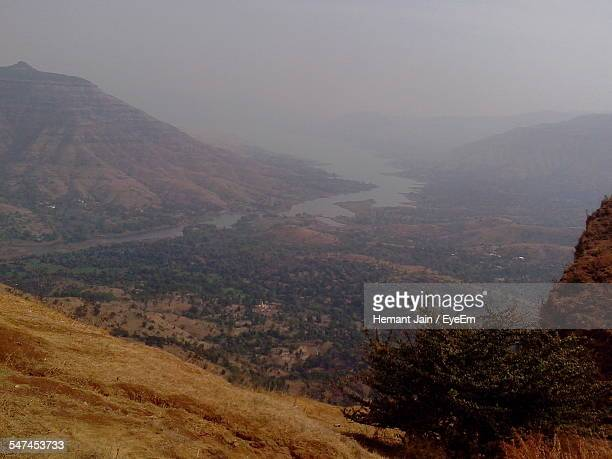 High Angle View Of River And Mountains In Foggy Weather