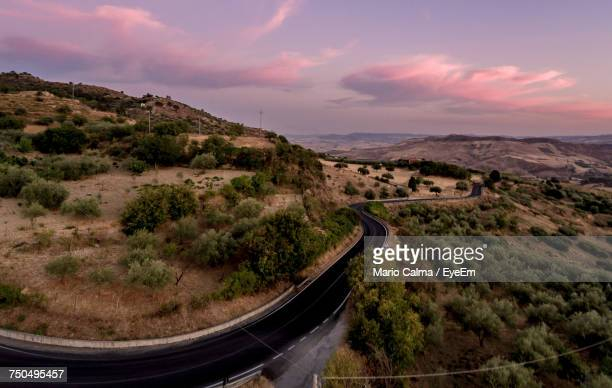 High Angle View Of Road Amidst Landscape Against Sky During Sunset