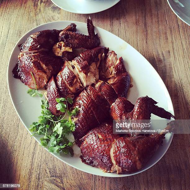 High Angle View Of Roasted Goose Served In Plate On Table