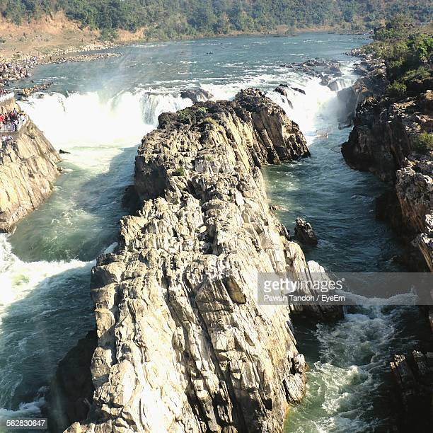 High Angle View Of Rock Formation Amidst River