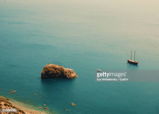 High Angle View Of Rocks In Sea Against Sky