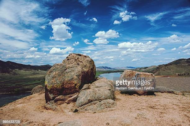 High Angle View Of Rocks On Field Against Sky