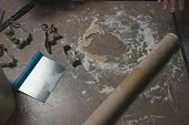 High Angle View Of Rolling Pin And Pastry Cutter On Table