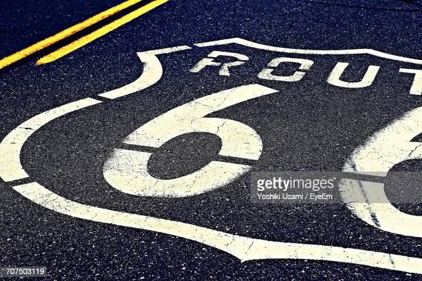 High Angle View Of Route 66 Sign On Road