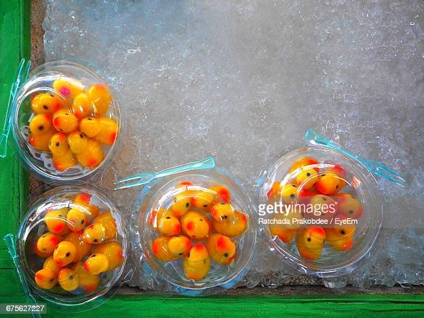 High Angle View Of Rubber Duck Shaped Food In Jars