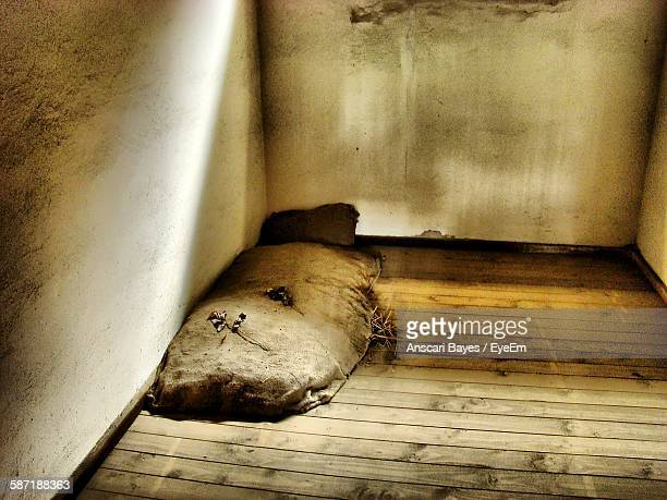 High Angle View Of Sack Bed In Prison Cell