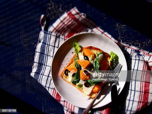High Angle View Of Salad On Toasted Bread In Plate