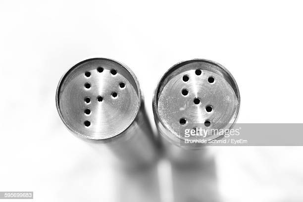 High Angle View Of Salt And Pepper Pots On White Background
