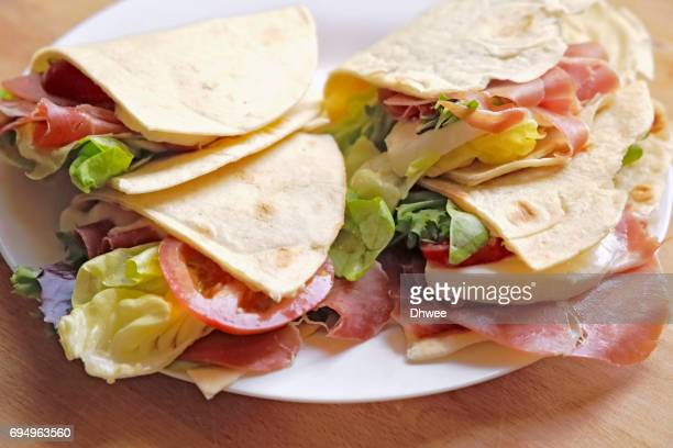 High Angle View Of Sandwich Tortilla Wraps on Plate
