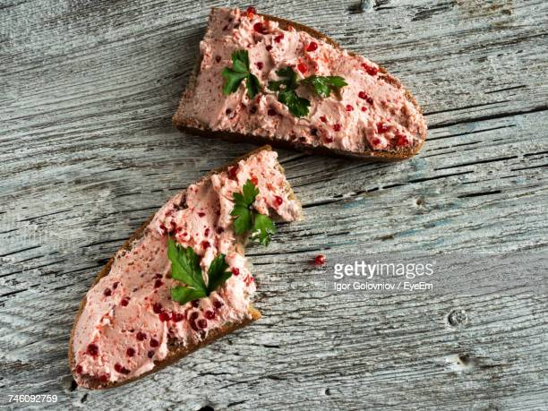 High Angle View Of Sandwiches On Wooden Table