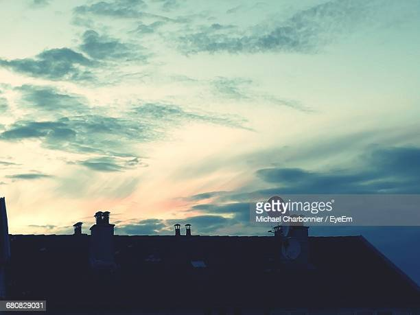 High Angle View Of Satellite Dish On House Roof Against Sky During Sunset