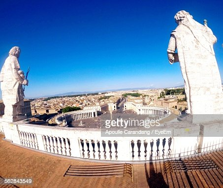 High Angle View Of Sculptures Over City At St Peter Square Against Clear Blue Sky