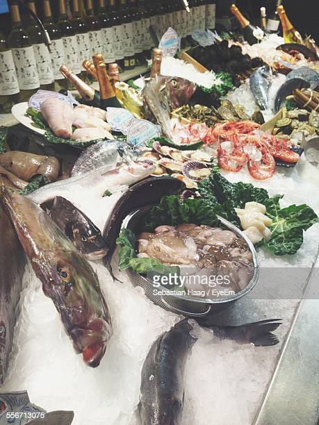 High Angle View Of Seafood And Champagne Bottles Stored In Restaurant Kitchen