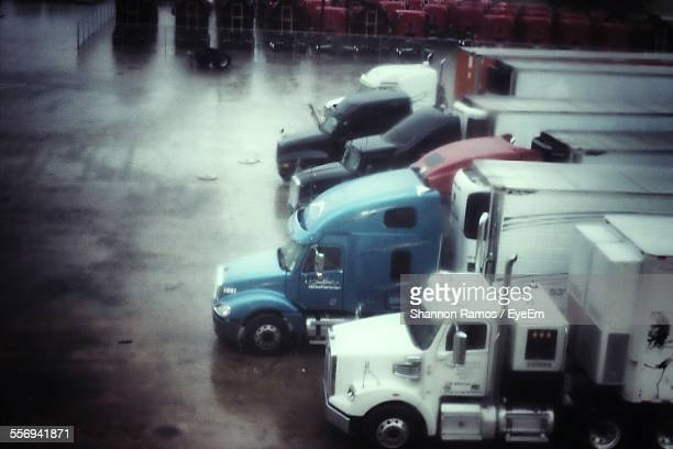 High Angle View Of Semi-Trucks On Parking Lot