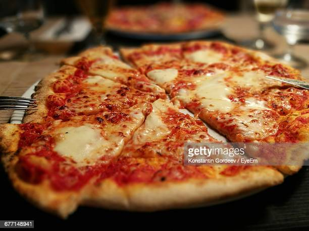 High Angle View Of Served Pizza