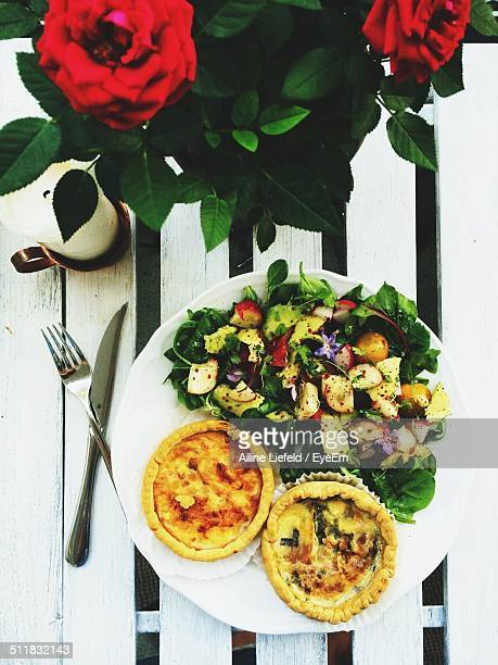 High angle view of serving salad with quiche