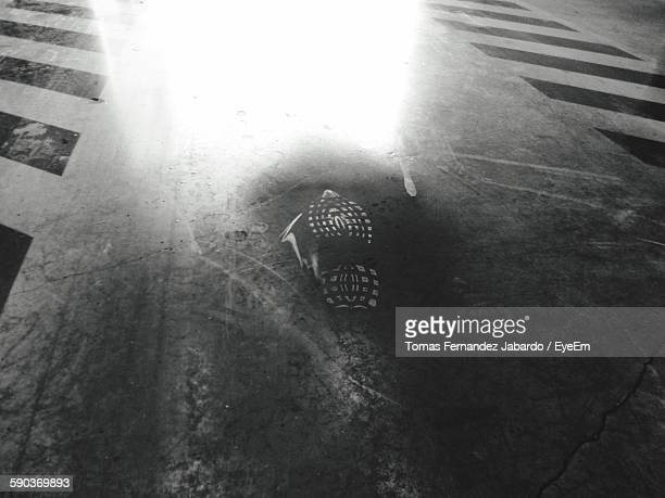 High Angle View Of Shoe Print On Floor At Parking Lot