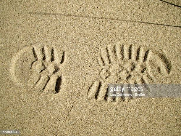 High Angle View Of Shoe Print On Sand