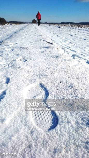 High Angle View Of Shoe Print On Snow Covered Field