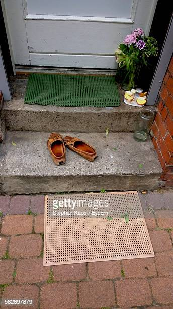High Angle View Of Shoes On Doorstep