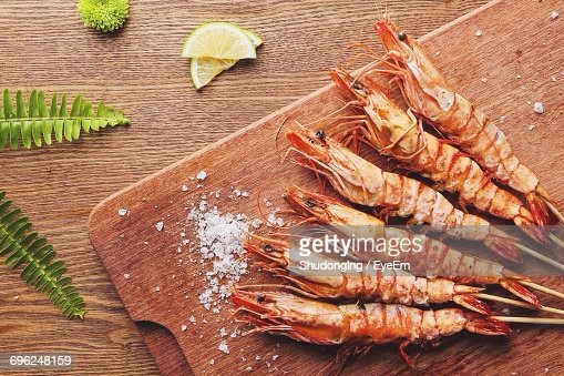High Angle View Of Shrimp On Wood