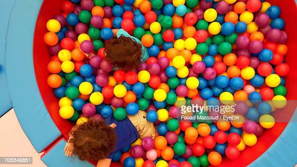 High Angle View Of Sibling Playing In Ball Pool