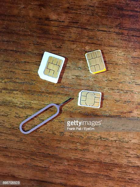 High Angle View Of Sim Cards With Eject Pin On Table