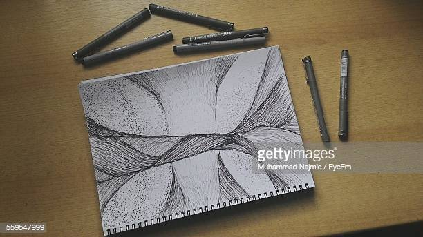 High Angle View Of Sketch On Spiral Book