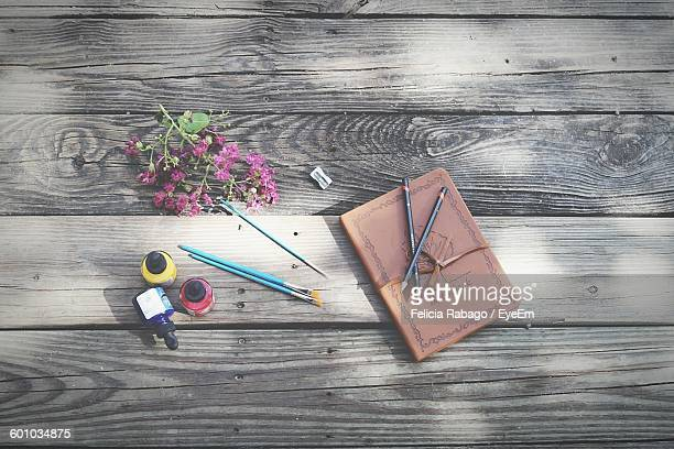 High Angle View Of Sketch Pad On Wooden Table